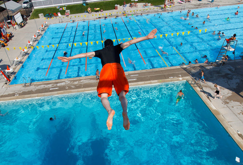Trent Nelson  |  The Salt Lake Tribune Enoch Foster dives from the platform at the Cottonwood Heights Recreation Center Wednesday July 10, 2013.