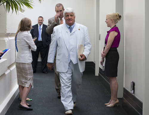 "Rep. Bob Bishop, R-Utah, emerges from a closed-door meeting with House Republicans after working on an approach to immigration reform, at the Capitol in Washington, Wednesday, July 10, 2013. The GOP leadership rejected the immigration bill passed by the Democratic-controlled Senate, saying in a statement, ""House committees will continue their work on a step-by-step, common-sense approach to fixing what has long been a broken system.""   (AP Photo/J. Scott Applewhite)"