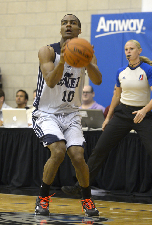 Utah Jazz guard Alec Burks (10) sets up for a shot during the first half of an NBA Orlando Pro Summer League game against the Miami Heat in Orlando, Fla., Sunday, July 7, 2013. (Special to the Tribune/Phelan M. Ebenhack)