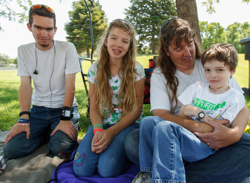 Trent Nelson  |  The Salt Lake Tribune Laura Privett and her children, Wade, Makayla and Kayden, relax in David Gourley park in Kearns. Privett's children have all benefitted from Medicaid coverage, which provided access to pediatric dentists who can do specialty work other dentists can't. Some of Utah's pediatric dentists now object to upcoming changes in how they are paid for caring for Medicaid patients.
