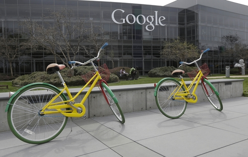 FILE - This March 15, 2013, file photo shows Google bicycles at the Google campus in Mountain View, Calif. In the era of intense government surveillance and secret court orders, a murky multimillion-dollar market has emerged. Paid for by U.S. tax dollars, but with little public scrutiny, surveillance fees charged in secret by technology and phone companies can vary wildly. While Microsoft, Yahoo and Google won't say how much they charge, the American Civil Liberties Union found that email records can be turned over for as little as $25.  (AP Photo/Jeff Chiu, File)