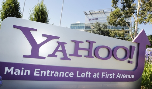 FILE - This July 16, 2012 file photo shows the Yahoo headquarters in Sunnyvale, Calif. In the era of intense government surveillance and secret court orders, a murky multimillion-dollar market has emerged. Paid for by U.S. tax dollars, but with little public scrutiny, surveillance fees charged in secret by technology and phone companies can vary wildly. While Microsoft, Yahoo and Google won't say how much they charge, the American Civil Liberties Union found that email records can be turned over for as little as $25. (AP Photo/Paul Sakuma, File)
