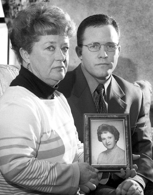 FILE - In this undated black and white file photo, Diane Dodd, left, and son Casey Sherman hold a photo in Rockland, Mass., of Dodd's sister Mary Sullivan, who was found strangled in January 1964 and is believed to have been the last victim of the Boston Strangler. Albert DeSalvo confessed to the string of 1960's killings but was never convicted. He died in prison in the 1970s. Massachusetts officials said Thursday, July 11, 2013, that DNA technology led to a breakthrough, putting them in a position to formally charge the Boston Strangler with the murder of Mary Sullivan. (AP Photo/Patriot Ledger, Greg Derr, File) MANDATORY CREDIT. BOSTON GLOBE OUT. BOSTON HERALD OUT.