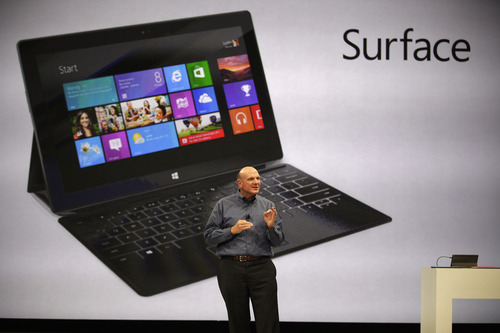(AP Photo/Damian Dovarganes) Microsoft CEO Steve Ballmer unveils Surface, a tablet computer to compete with Apple's iPad, at Hollywood's Milk Studios in Los Angeles. Microsoft is reshuffling its business in a move that it says will allow it to innovate faster and focus on devices and services.