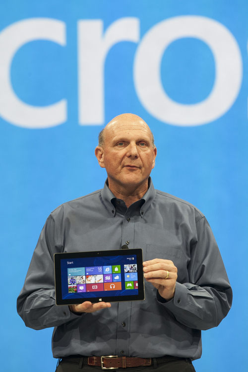 """Microsoft CEO Steve Ballmer unveils """"Surface"""", a new tablet computer to compete with Apple's iPad at Hollywood's Milk Studios in Los Angeles Monday, June 18, 2012. Microsoft is reshuffling its business in a move that it says will allow it to innovate faster and focus on devices and services.(AP Photo/Damian Dovarganes)"""