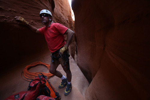 Francisco Kjolseth  |  The Salt Lake Tribune Slot canyon guide Rick Green keeps an eye on the progress being made by his group through one of the many slot canyons in the Grand Staircase-Escalante National Monument.