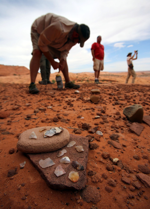 Francisco Kjolseth  |  The Salt Lake Tribune An overlook in the Grand Staircase-Escalante National Monument reveals what was most likely a popular gathering spot for ancient Native American civilizations as the group gets a closer look at some of their tools, always leaving them behind for others to see.