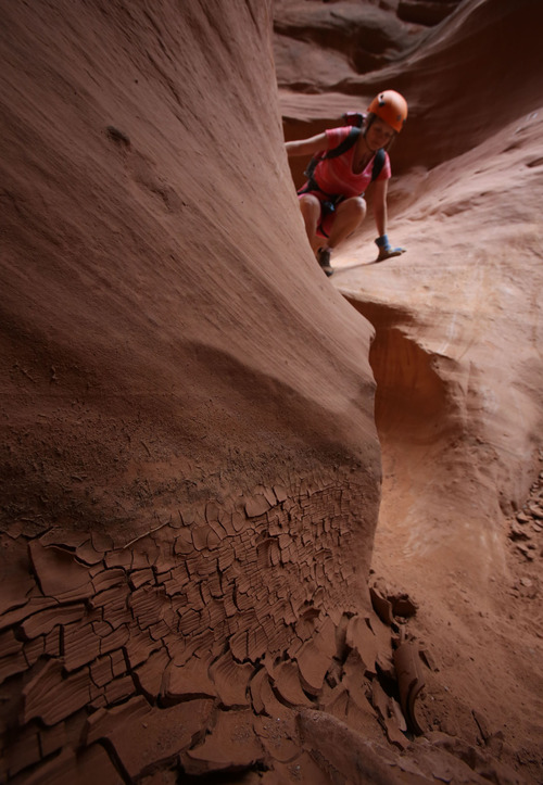 Francisco Kjolseth  |  The Salt Lake Tribune An extended forecast is always checked to avoid flash floods, which are revealed in the mud as Kristin Wold of Portland Oregon navigates a small drop in one of the many slot canyons in southern Utah.