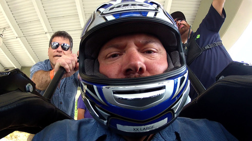 Courtesy KUED | Salt Lake Tribune writer Brett Prettyman prepares for his ride on the bobsled during the summer at Utah Olympic Park while filming for The Utah Bucket List show that will air on KUED-Channel 7 in August.