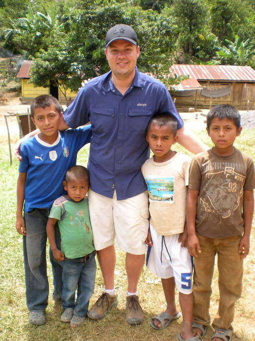 Photo Credit: Courtesy of DownEast  Kenny Wright, 32, of Orem, in June with children from the Chirixquitzac village in Guatemala's mountainous Polochic region.
