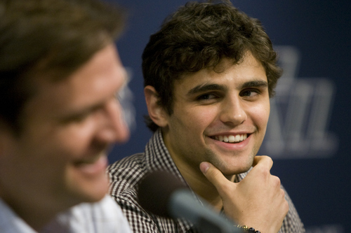 Utah Jazz draft pick Raul Neto, right, smiles during the team's NBA basketball news conference, Friday, June 28, 2013, in Salt Lake City. (AP Photo/Salt Lake Tribune, Rick Egan) DESERET NEWS OUT; LOCAL TV OUT; MAGS OUT.