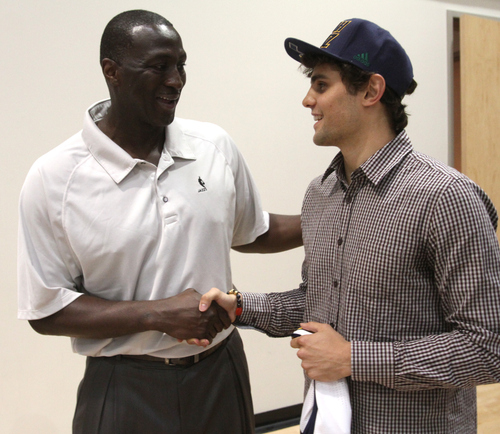 Rick Egan  | The Salt Lake Tribune   Raul Neto chats with coach Tyrone Corbin, at the Jazz practice facility,  Friday, June 28, 2013.