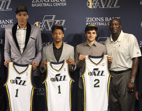 Utah Jazz basketball team introduces draft picks Rudy Cobert, left, Trey Burke and Raul Neto (2) with head coach Tyron Corbin during a NBA media conference, Friday, June 28, 2013, in Salt Lake City. (AP Photo/The Salt Lake Tribune, Rick Egan) DESERET NEWS OUT; LOCAL TV OUT; MAGS OUT.