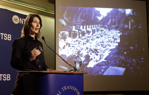 Deborah Hersman of the National Transportation Safety Board speaks in front of a photograph of some seats of Asiana Flight 214, which crashed on Saturday, July 6, 2013, at San Francisco International Airport, at a news conference in South San Francisco, Calif., Thursday, July 11, 2013. (AP Photo/Jeff Chiu)