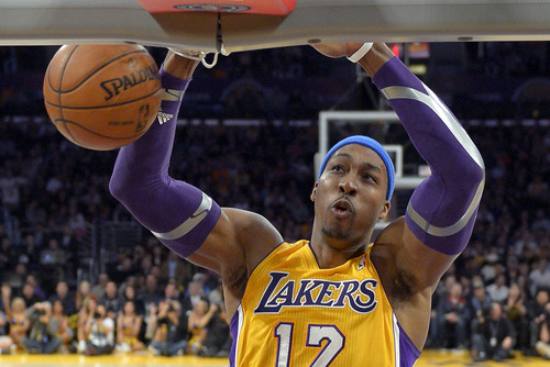 Dwight Howard left the Lakers for the Houston Rockets, reportedly because he disliked coach Mike D'Antoni's system, and because he didn't want to play in Kobe Bryant's shadow. (AP Photo/Mark J. Terrill, File)