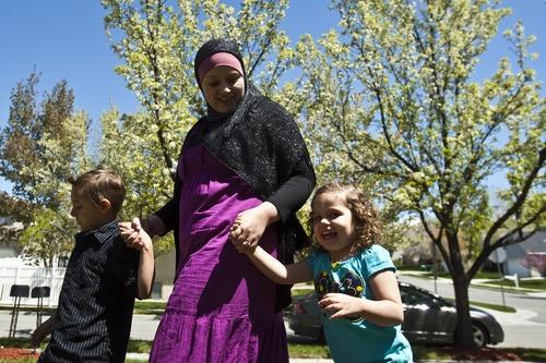 Chris Detrick | The Salt Lake Tribune  Sharifa Al-Qaaydeh and her kids Sajed, 5, and Summer, 3, walk around their home Wednesday May 4, 2011.