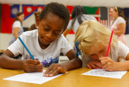 Trent Nelson  |  The Salt Lake Tribune Eli and Isabelle Hill color pages to go in welcome kits for faculty and staff at Woodrow Wilson Elementary School in Salt Lake City, Thursday as part of United Way's Summer of Service.