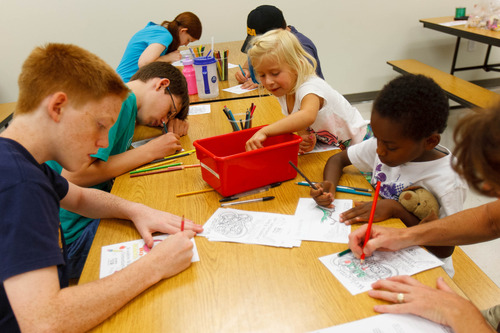 Trent Nelson  |  The Salt Lake Tribune Kids color pages to go in a welcome kit for faculty and staff at Woodrow Wilson Elementary School in Salt Lake City, Thursday as part of United Way's Summer of Service.