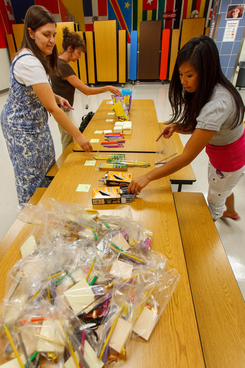 Trent Nelson  |  The Salt Lake Tribune Misti Mitchell, Jill Hill and Elizabeth Romrell assemble kits for faculty and staff at Woodrow Wilson Elementary School in Salt Lake City, Thursday as part of United Way's Summer of Service.
