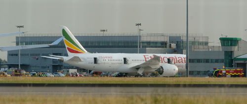 CORRECTING THE SPELLING OF SHEBA General view of the Air Ethiopian Boeing 787 Dreamliner 'Queen of Sheba' aeroplane, on the runway near Terminal 3, at Heathrow Airport, London, Friday July 12, 2013. Two Boeing 787 Dreamliner planes ran into trouble in England on Friday, with a fire on one temporarily shutting down Heathrow Airport and an unspecified technical issue forcing another to turn back to Manchester Airport.  The incidents are unwelcome news for Chicago-based Boeing Co., whose Dreamliners were cleared to fly again in April after a four-month grounding due to concerns about overheating batteries. The fire at Heathrow involved an empty Ethiopian Airlines plane, which was parked at a remote stand of the airport after arriving at the airport. British police said the fire is being treated as unexplained, and that there were no passengers on board at the time of the fire.  (AP Photo/ Anthony Devlin/PA) UNITED KINGDOM OUT NO SALES NO ARCHIVE