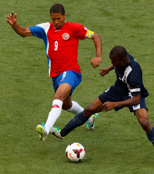Trent Nelson     The Salt Lake Tribune Costa Rica's Alvaro Saborio gets tangled up with Belize's Elroy Smith (8) defending as Costa Rica defeats Belize 1-0 in CONCACAF Gold Cup soccer at Rio Tinto Stadium in Sandy, Saturday July 13, 2013.