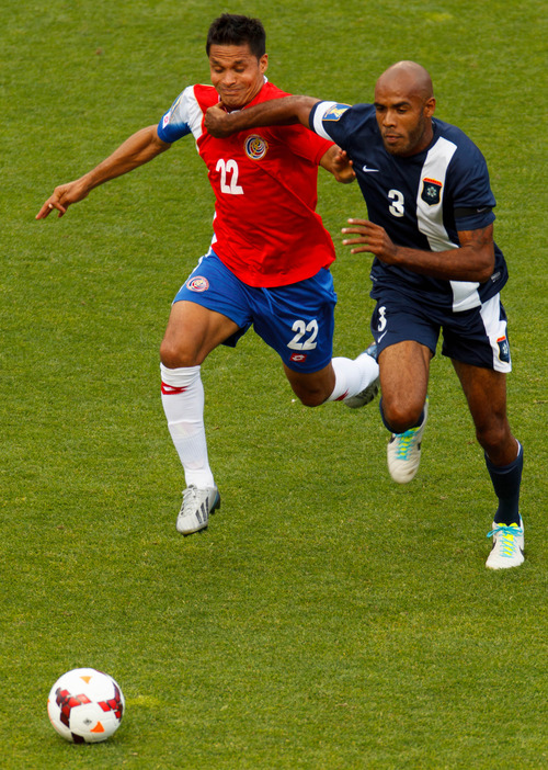 Trent Nelson     The Salt Lake Tribune Costa Rica's Jairo Arrieta and Belize's Trevor Lennen chase down the ball as Costa Rica defeats Belize 1-0 in CONCACAF Gold Cup soccer at Rio Tinto Stadium in Sandy, Saturday July 13, 2013.