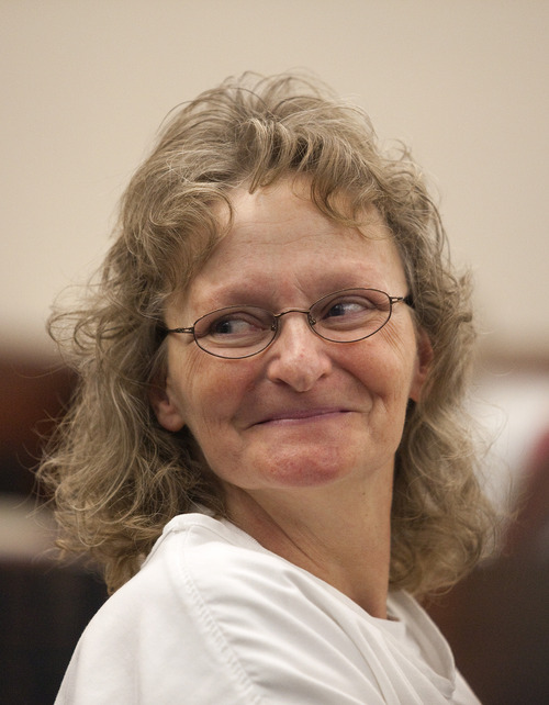 Erin Hooley | The Associated Press Debra Brown, 53, smiles at the audience during a hearing in Judge Michael DiReda's 2nd District Court in Ogden Wednesday, Jan. 19, 2011. She was convicted in the shooting death of her employer Lael Brown, no relation,  in 1995, but is  now the first Utah inmate to try the Factual Innocence Statute law that allows for non-DNA innocence claims.