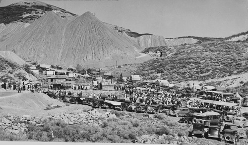 "Salt Lake Tribune archive  The town of Mercur, Utah first came into being in 1870 as Lewiston, when gold was discovered at the head of the Lewiston Canyon. A small gold rush began, peaking about 1873. The population reached as high as 2000. Lewiston became a ghost town by 1880 when the ore ran out. In 1890 the gold rush started all over again, and a new town sprang to life on the old site, but the name of Lewiston was already taken by then, so the citizens settled on the name Mercur, In 1902 a fire that started in the business district of the town burned almost the entire city to the ground. The town was rebuilt and mining resumed again. In its heyday, there were about 5,000 residents of Mercur. By 1913 all the mines were closed and by 1916 there was only one building left in Mercur. Mercur supported a large Italian immigrant community. Young men were attracted by the opportunity of high wages and the romance of the American ""wild west."" With this Italian influence, Columbus Day became an important city event including parades, games and performances by the Mercur City Band."