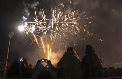 Rick Egan   |  The Salt Lake Tribune                                                                                                                                                                                                                                         Salt Lake Bees fans enjoy the fireworks at Spring Mobile Ball Park, Sunday, July 4, 2010