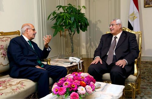 FILE - This Saturday, July 6, 2013 file photo released by the office of the Egyptian Presidency on Saturday, July 6, 2013 shows Mohamed Elbaradei, left, meeting with interim president Adly Mansour, right, at the presidential palace. Liberal and youth movements that backed the military's removal of Islamist President Mohammed Morsi are now fighting to make their calls for reform heard as they push back against the military's strong grip on the new leadership. At stake is the hope that the Arab world's most populous nation will emerge from more than two years of turmoil as a democracy. (AP Photo/Egyptian Presidency, File)
