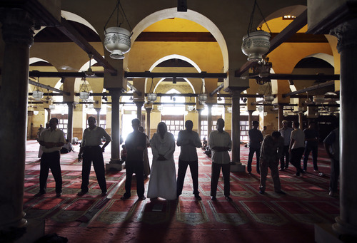 Egyptian men attend the afternoon prayer at al-Azhar mosque during the Muslim holy month of Ramadan in Cairo, Egypt, Sunday, July 14, 2013. Ramadan is traditionally a time of reflection and prayer, and observant Muslims are expected to abstain during daylight hours from food, drink, smoking and sex to focus on spirituality, good deeds and charity. (AP Photo/Hussein Malla)