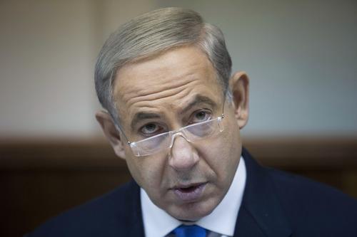 Israeli Prime Minister Benjamin Netanyahu attends a weekly cabinet meeting in his Jerusalem office in Israel Sunday, July 14, 2013. (AP Photo/Abir Sultan, Pool)