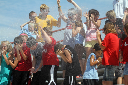 Photo courtesy Burlington Bees  Children play in the Splash Zone at Community Field, home of the Burlington, Iowa Bees, a minor league affiliate of the Los Angeles Angels.