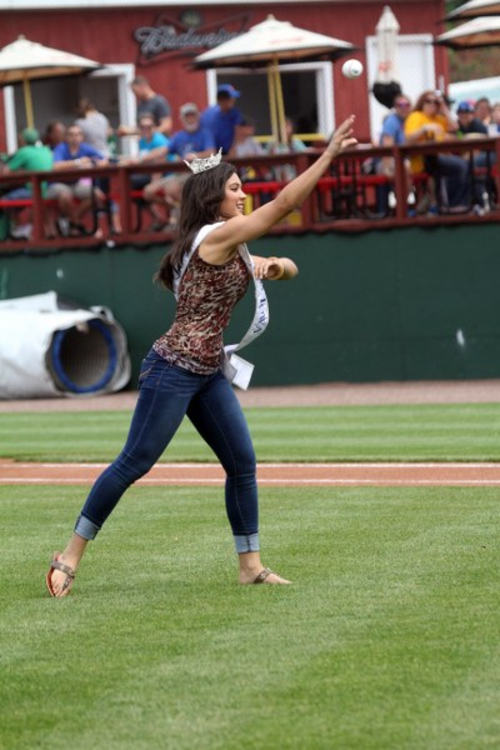Photo courtesy Burlington Bees  Burlington native and 2012 Miss Iowa, Mariah Cary, throws out a ceremonial first pitch. Mariah finished fourth runner up in the 2013 Miss America Pageant.