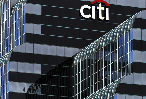 FILE - This Wednesday, Dec. 5, 2012 file photo, shows a Citi Bank sign  in Chicago. Citigroup turned in a strong first quarter, but the sentiment from the bank was more cautious than celebratory.  Citigroup Inc. reports quarterly financial results before the market opens on Monday, July 15, 2013. (AP Photo/Kiichiro Sato, File)