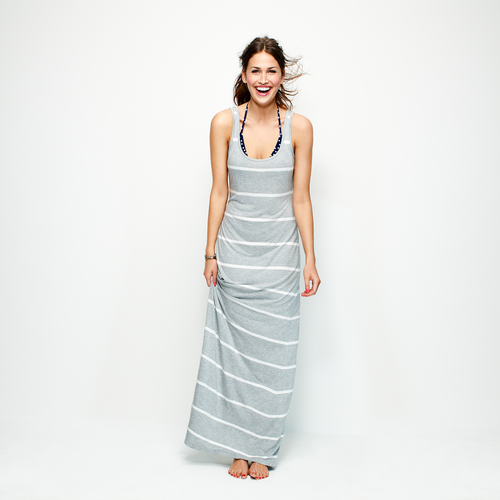 This product image released by Old Navy shows a gray and white striped maxi dress. Many stores are recognizing that shoppers like to purchase their summer clothing when the weather is warm enough for them to wear it. That translates to a later, more gradual rollout of summer clothing as well as staggered and later-than-usual sales. (AP Photo/Old Navy)