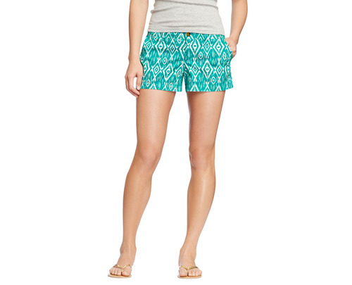 This product image released by Old Navy shows teal-printed shorts. Many stores are recognizing that shoppers like to purchase their summer clothing when the weather is warm enough for them to wear it. That translates to a later, more gradual rollout of summer clothing as well as staggered and later-than-usual sales. (AP Photo/Old Navy)