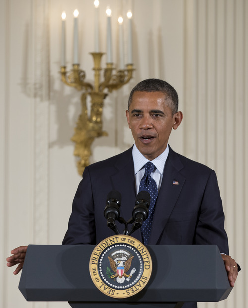 President Barack Obama speaks during a ceremony to present the 5,000th Daily Point of Light Award to Floyd Hammer and Kathy Hamilton, from Union, Iowa, in the East Room of the White House in Washington, Monday, July 15, 2013.   Obama will try to ratchet up pressure on House Republicans this week to pass legislation overhauling the nation's immigration laws.  He will do interviews from the White House Tuesday with Spanish language television stations from Dallas, Denver, Los Angeles and New York. The White House says the president will argue that immigration reform is in line with the nation's values and in the country's economic interests.    (AP Photo/Carolyn Kaster)