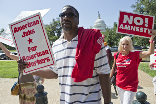 """People opposed to current immigration legislation in Congress gather at a rally on Capitol Hill in Washington, Monday, July 15, 2013. The event is sponsored by a group called the Black American Leadership Alliance, which, in their words, does not want to """"provide amnesty to over 11 million people who have entered the country illegally."""" (AP Photo/J. Scott Applewhite)"""