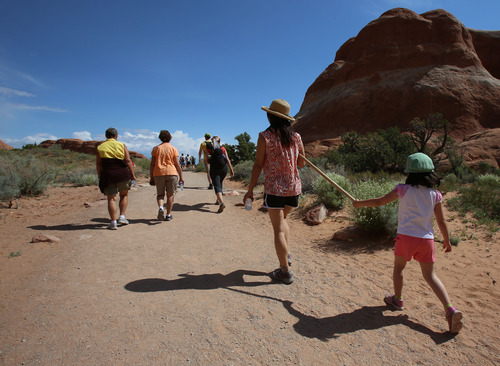 Francisco Kjolseth  |  The Salt Lake Tribune Visitors from around the world flock to Arches National Park year round.