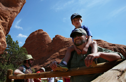 Francisco Kjolseth  |  The Salt Lake Tribune Tribune outdoors writer Brett Prettyman carries his son Owen, 4, while hiking the Devils Garden trail in Arches National Park.