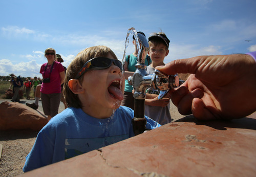 Francisco Kjolseth  |  The Salt Lake Tribune Johnny Prokop, 5, hydrates before the start of a long hike on short legs in Arches National Park in late May.