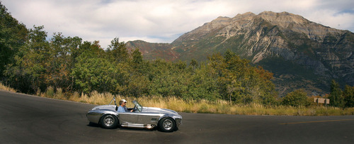 A sleek silver sports car cruises down Squaw Peak road in Provo Canyon Sept. 13, 2007 as Mt. Timpanogos looms in the background. Steve Griffin/The Salt Lake Tribune 9/13/07