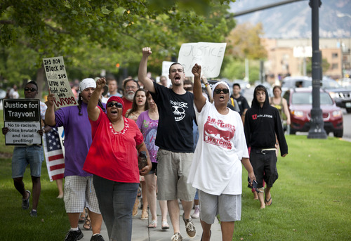 Lennie Mahler     The Salt Lake Tribune Protesters, from left: Angelo Martinez, Janet Cooper, James Hadden and Elaine Buie march around the Matheson Courthouse and chant during a rally condemning the verdict which found George Zimmerman not guilty of murdering Trayvon Martin. Salt Lake City, Utah. Monday, July 15, 2013.