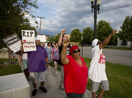 Lennie Mahler     The Salt Lake Tribune Protesters Janet Cooper and Elaine Buie, front, Angelo Martinez and James Hadden, second row, march around the Matheson Courthouse and chant during a rally condemning the verdict which found George Zimmerman not guilty of murdering Trayvon Martin. Salt Lake City, Utah. Monday, July 15, 2013.