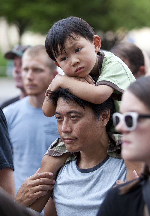 Lennie Mahler     The Salt Lake Tribune Edmund Fong and his son, Oscar, attend a rally to honor Trayvon Martin and condemn the ruling which found George Zimmerman not guilty of murder. Salt Lake City, Utah. Monday, July 15, 2013.