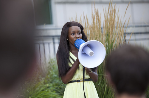 """Lennie Mahler     The Salt Lake Tribune Makuena Mohlakola sings """"Lift Every Voice and Sing"""" during a rally at the Matheson Courthouse to honor Trayvon Martin and condemn the verdict which found George Zimmerman not guilty of murder. Salt Lake City, Utah. Monday, July 15, 2013."""