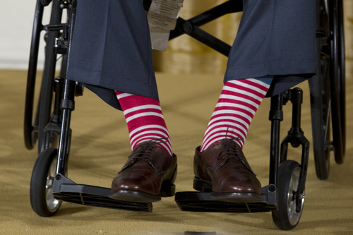 """Former President George H. W. Bush's striped socks are seen as he participated in a ceremony to  present the 5,000th Daily Point of Light Award to Floyd Hammer and Kathy Hamilton, a retired couple and farm owners from Union, Iowa, in the East Room of the White House in Washington, Monday, July 15, 2013. Obama welcomed Bush to the White House in a salute to public service and to the drive for volunteerism that the 41st president inspired with his """"thousand points of light"""" initiative more than two decades ago.  (AP Photo/Carolyn Kaster)"""