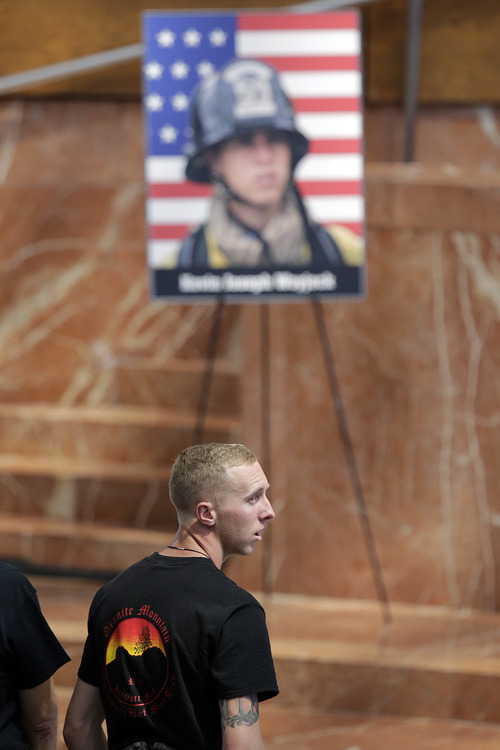 Brendan McDonough, the sole surviving member of the Granite Mountain Hotshots crew, attends funeral services for firefighter Kevin Woyjeck at Christ Cathedral on Tuesday, July 16, 2013, in Garden Grove, Calif. Woyjeck was among 19 firefighters who were killed while battling an Arizona wildfire on June 30. (AP Photo/Jae C. Hong)