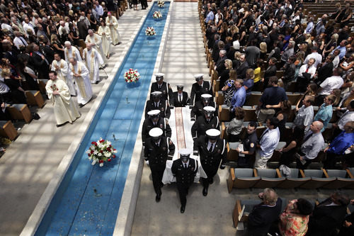 Pallbearers carrying the casket containing the body of firefighter Kevin Woyjeck leave after funeral services for Woyjeck at Christ Cathedral on Tuesday, July 16, 2013, in Garden Grove, Calif. Woyjeck was among 19 firefighters who were killed while battling an Arizona wildfire on June 30. (AP Photo/Jae C. Hong)